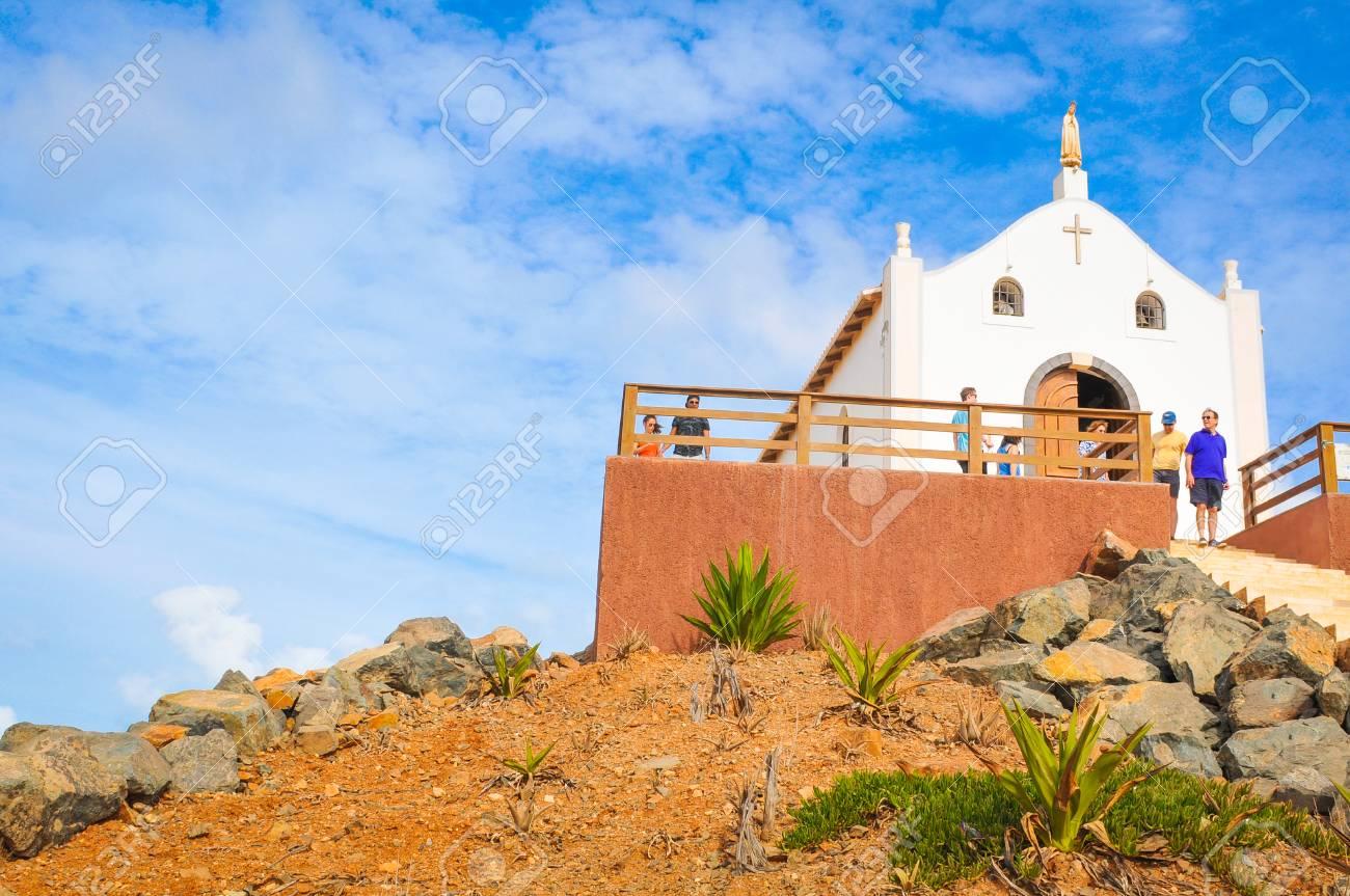 Boa Vista, Cape Verde - December 20, 2017: Tourists visit a catholic church on the island of Boa Vista, Cape Verde, Africa - 118177570