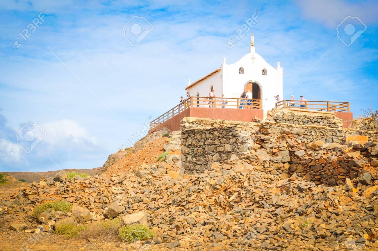 Boa Vista, Cape Verde - December 20, 2017: Tourists visit a catholic church on the island of Boa Vista, Cape Verde, Africa - 118177572