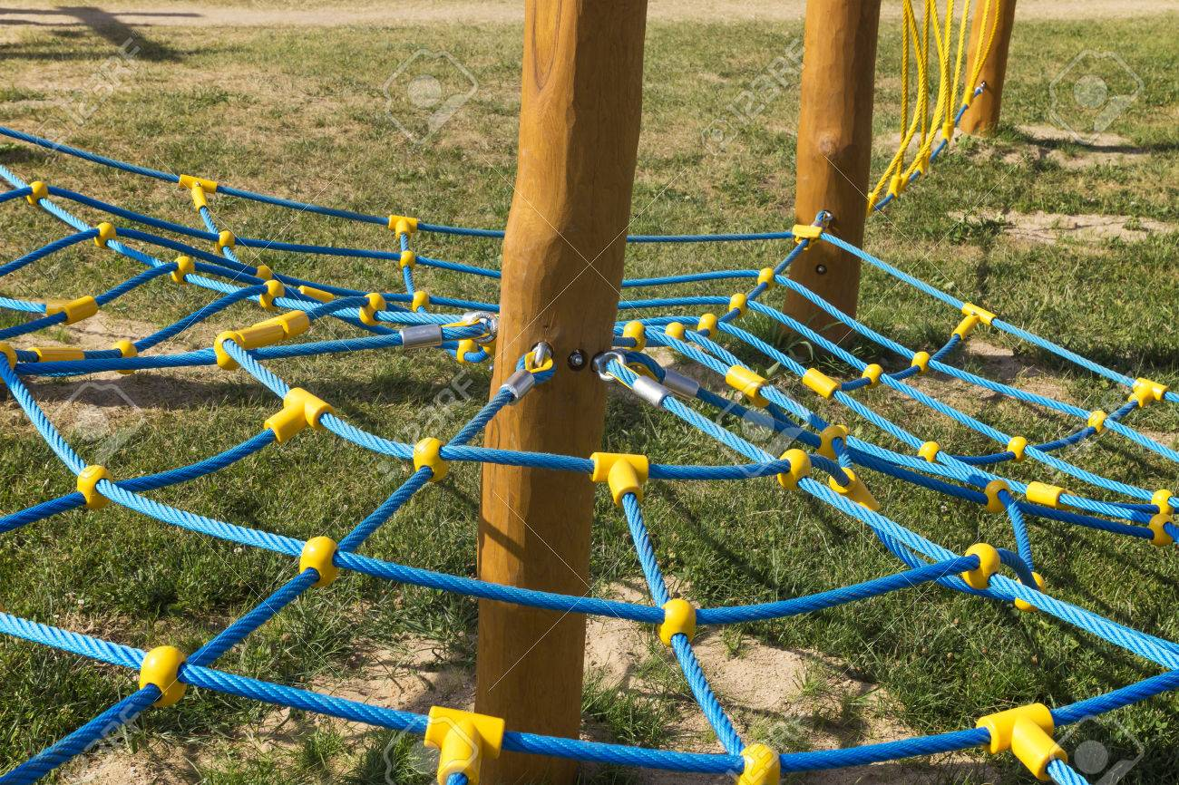 Rope Climbing Frame In The Shape Of Cobwebs On The Playground Stock ...