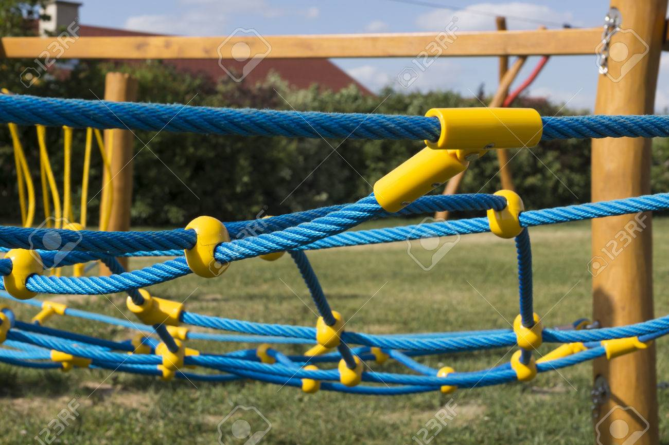 Yellow And Blue Rope-climbing Frame In The Playground Stock Photo ...