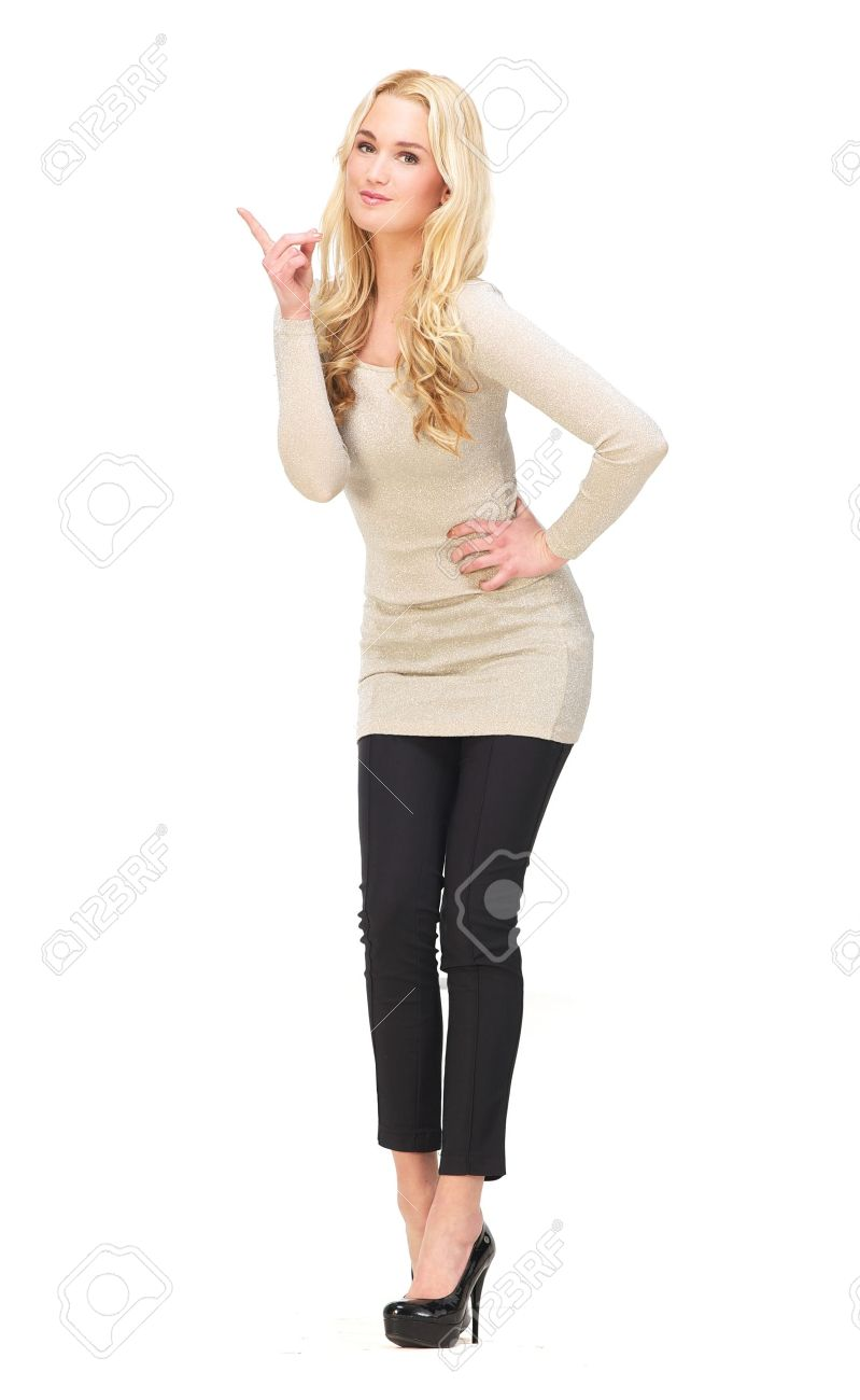 Full body portrait of a beautiful girl pointing her finger up isolated on white background possibility