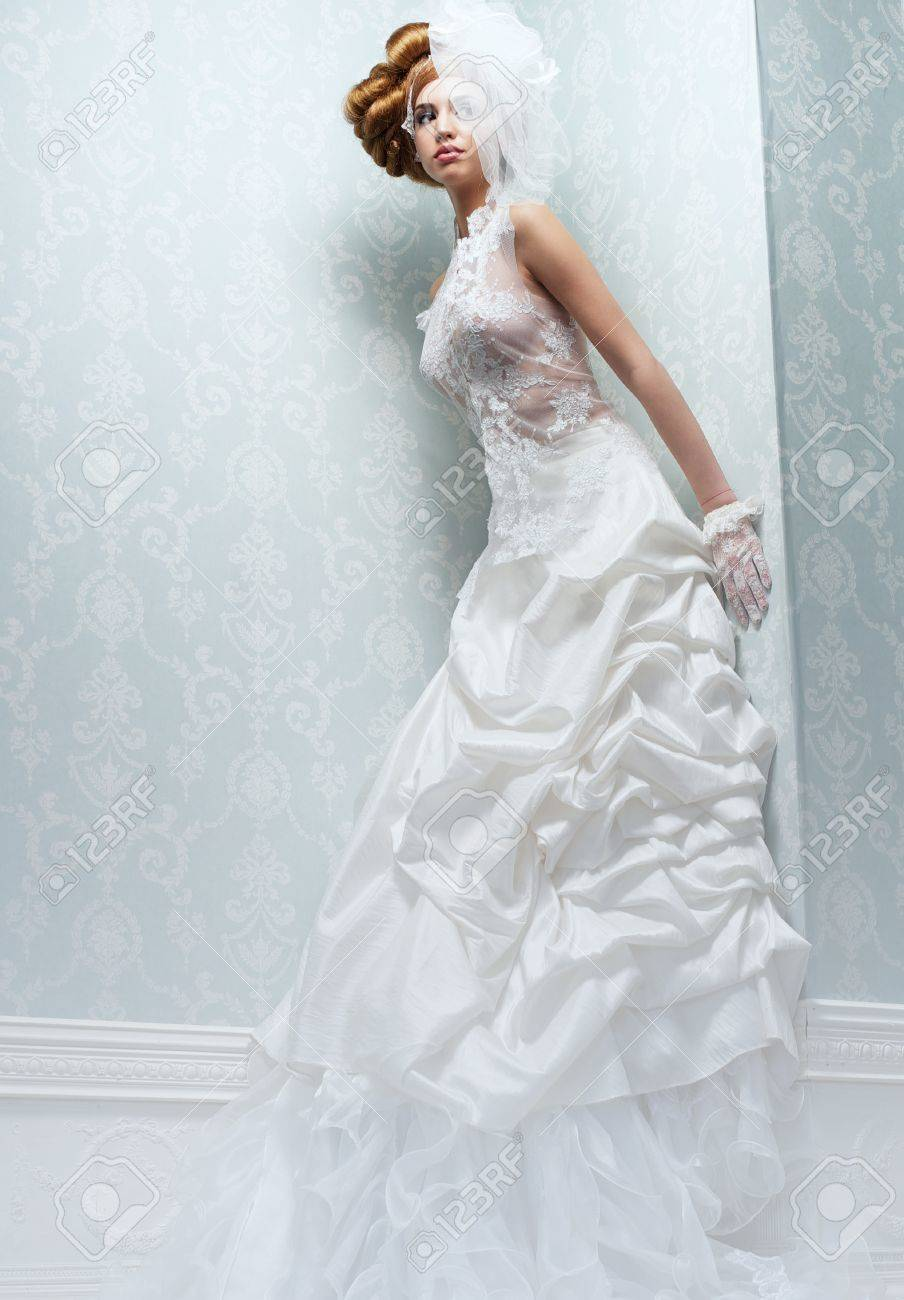 Beautiful Tall Bride With Long White Wedding Dress And Veil Stock ...