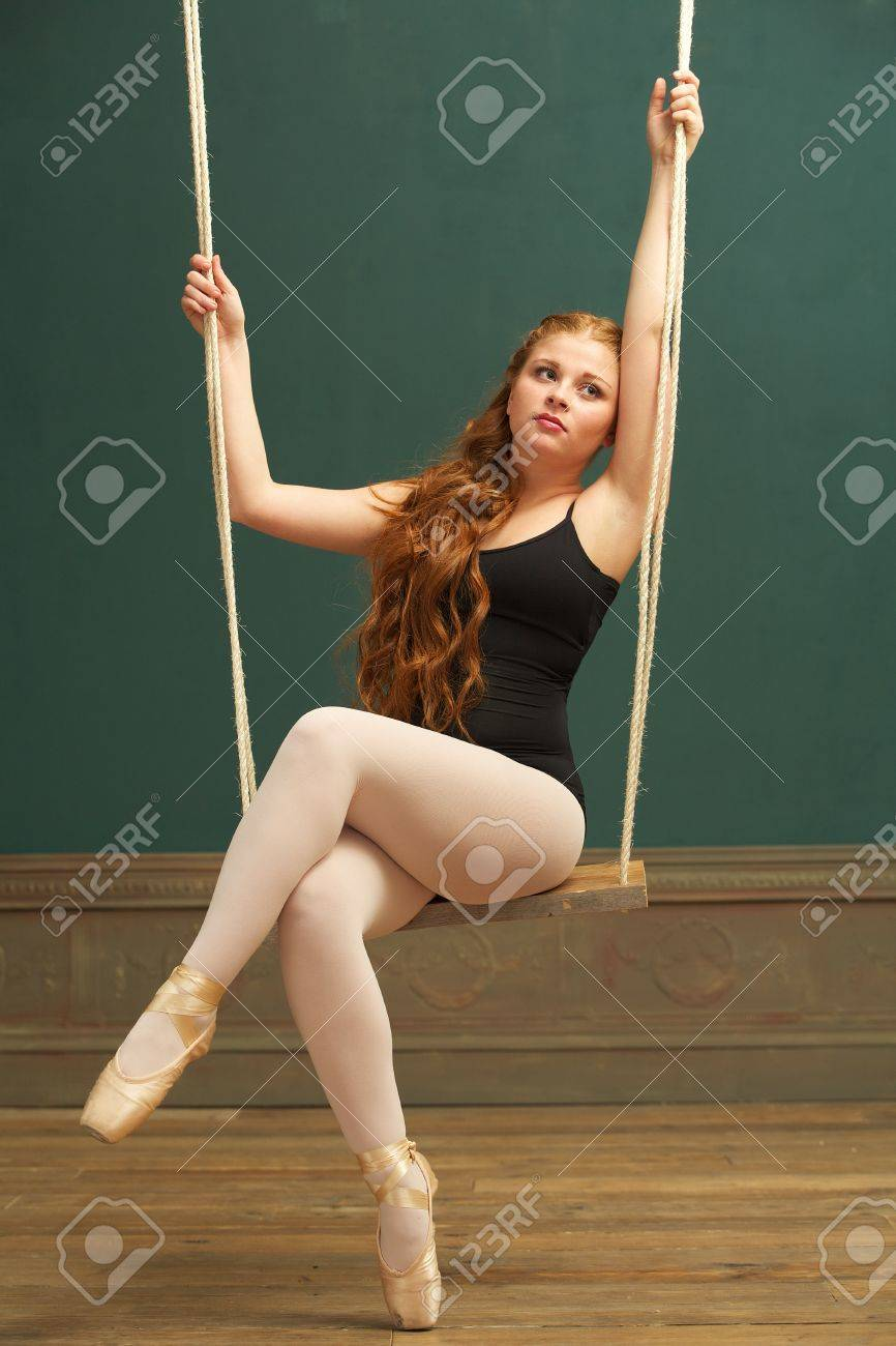 Portrait Of A Beautiful Ballerina Sitting On Swing Stock Photo ...