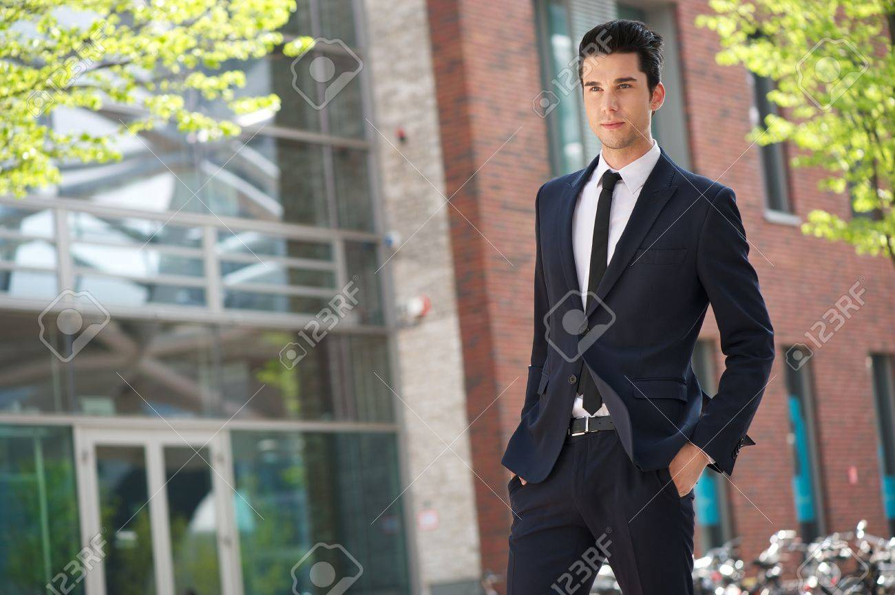 portrait of a handsome businessman walking to work stock photo portrait of a handsome businessman walking to work stock photo 19801132