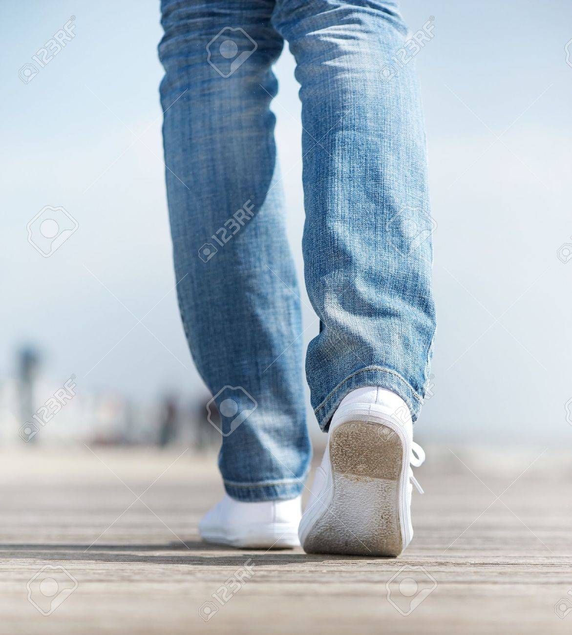 Close up of a woman walking outdoors in comfortable white shoes Stock Photo - 20081554