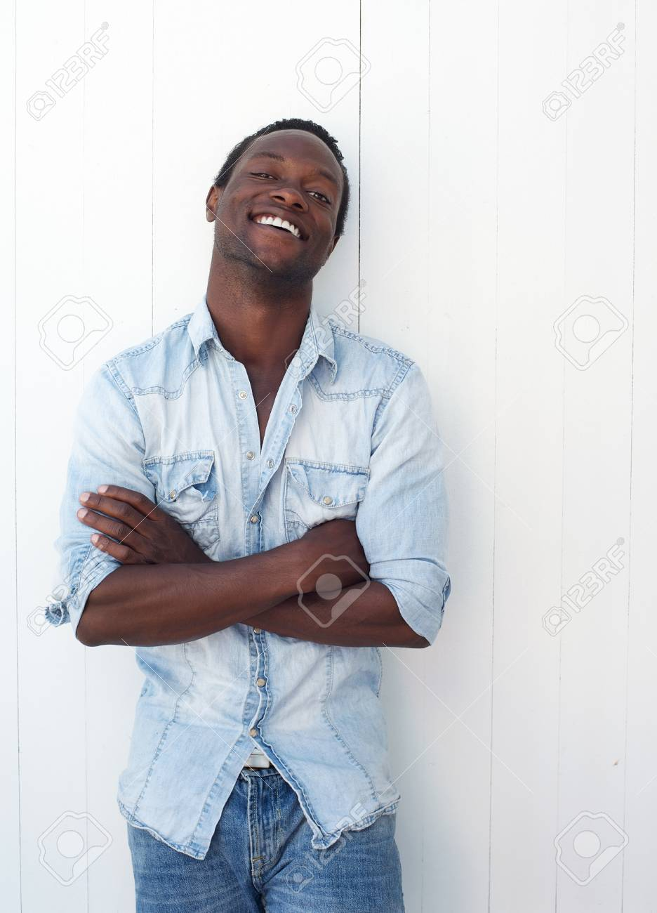 d4fb0f62c42 Closeup portrait of a happy young black man smiling outdoors against white  background Stock Photo -