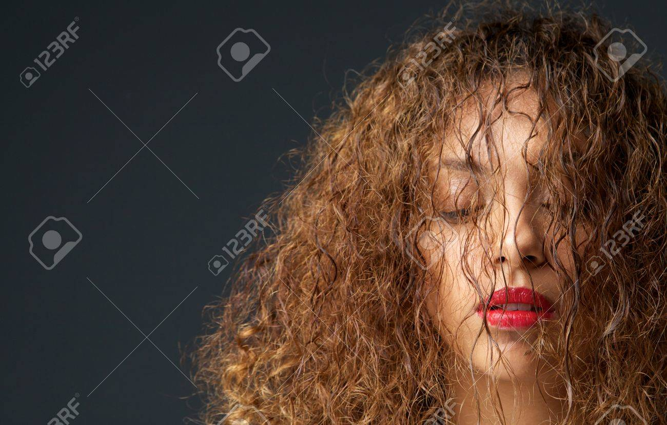 Close up portrait of a female fashion model with hair and eyes closed Stock Photo - 23372653