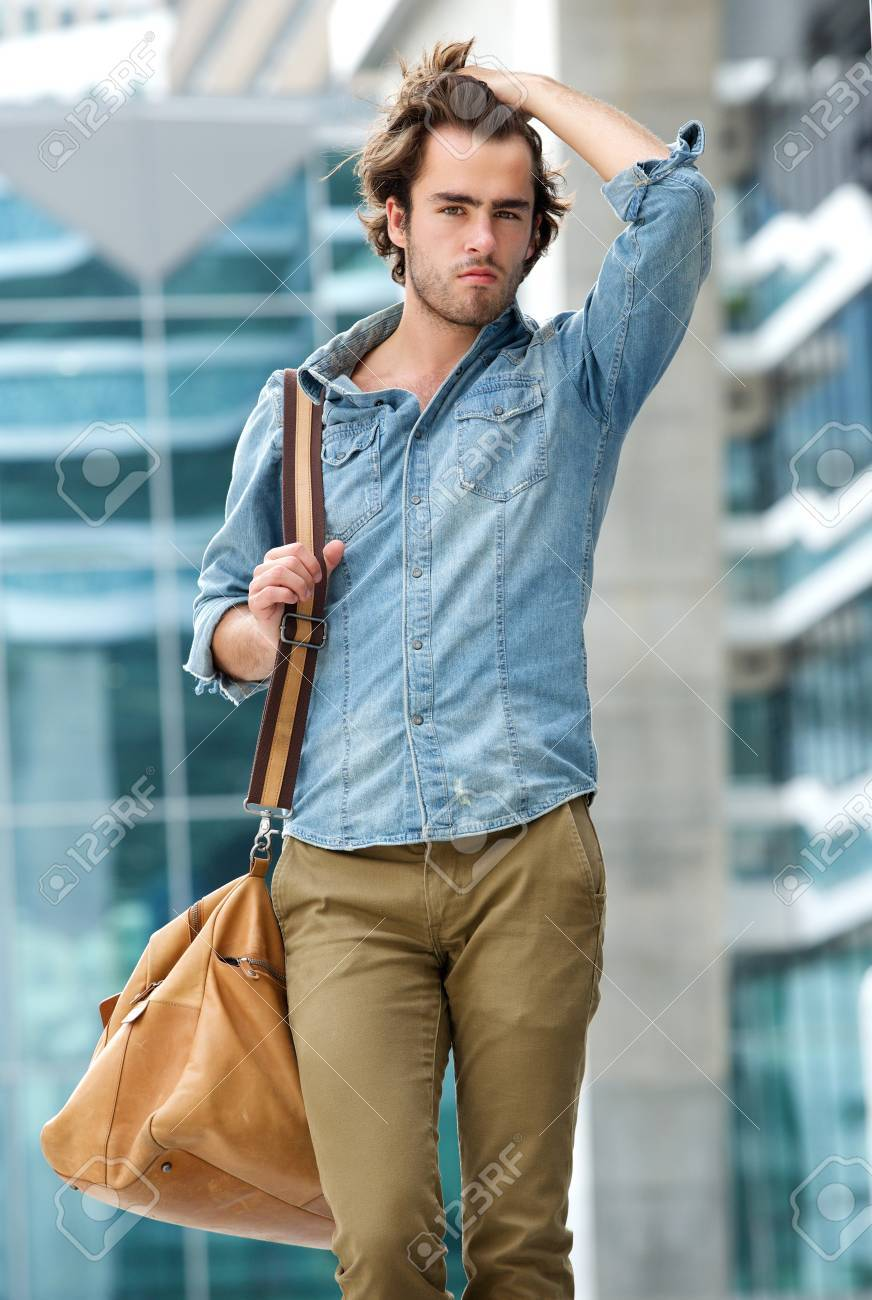 Portrait Of A Male Model Posing With Travel Bag Outdoors Stock Photo Picture And Royalty Free Image Image 30172540