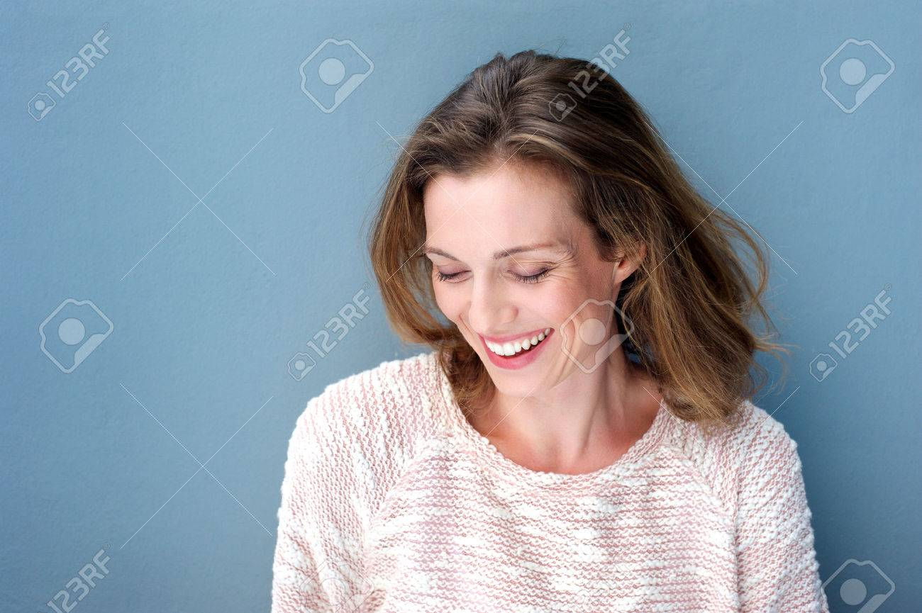 Close up portrait of a beautiful mid adult woman laughing with sweater - 37864511