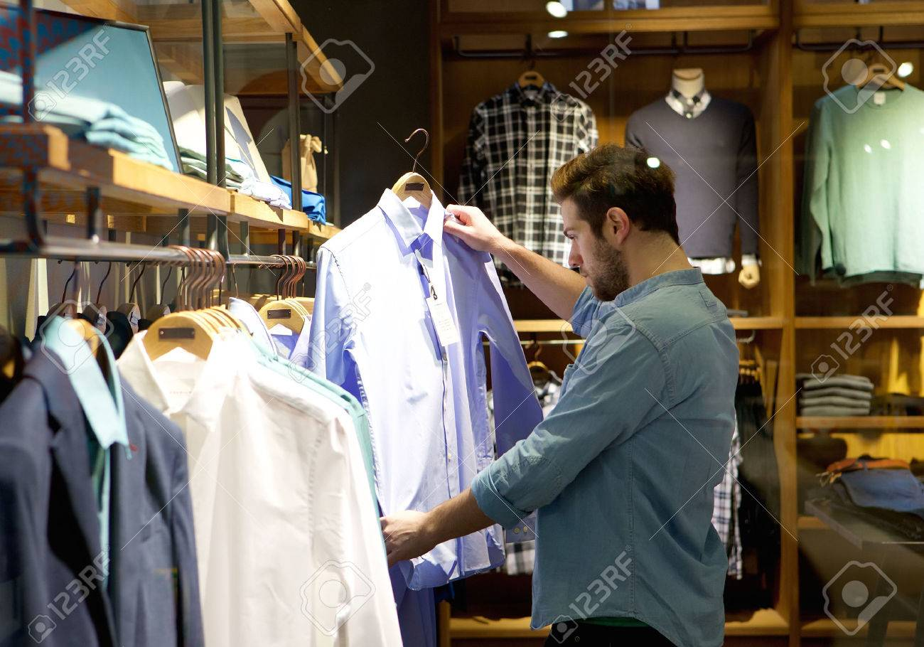 Portrait Of A Young Man Shopping For Clothes At Store Stock Photo ...