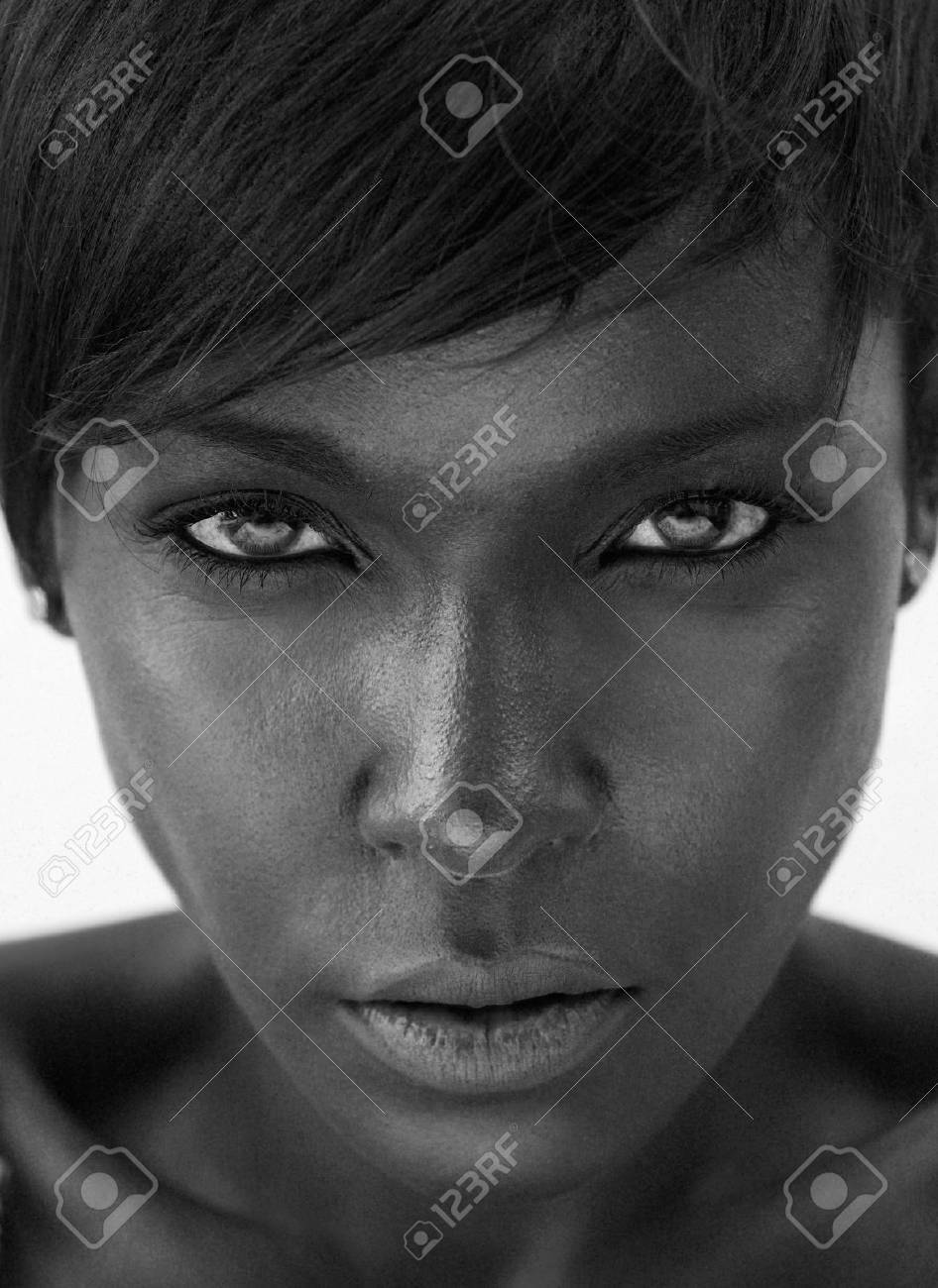 Close up black and white portrait of a beautiful african american woman staring stock photo