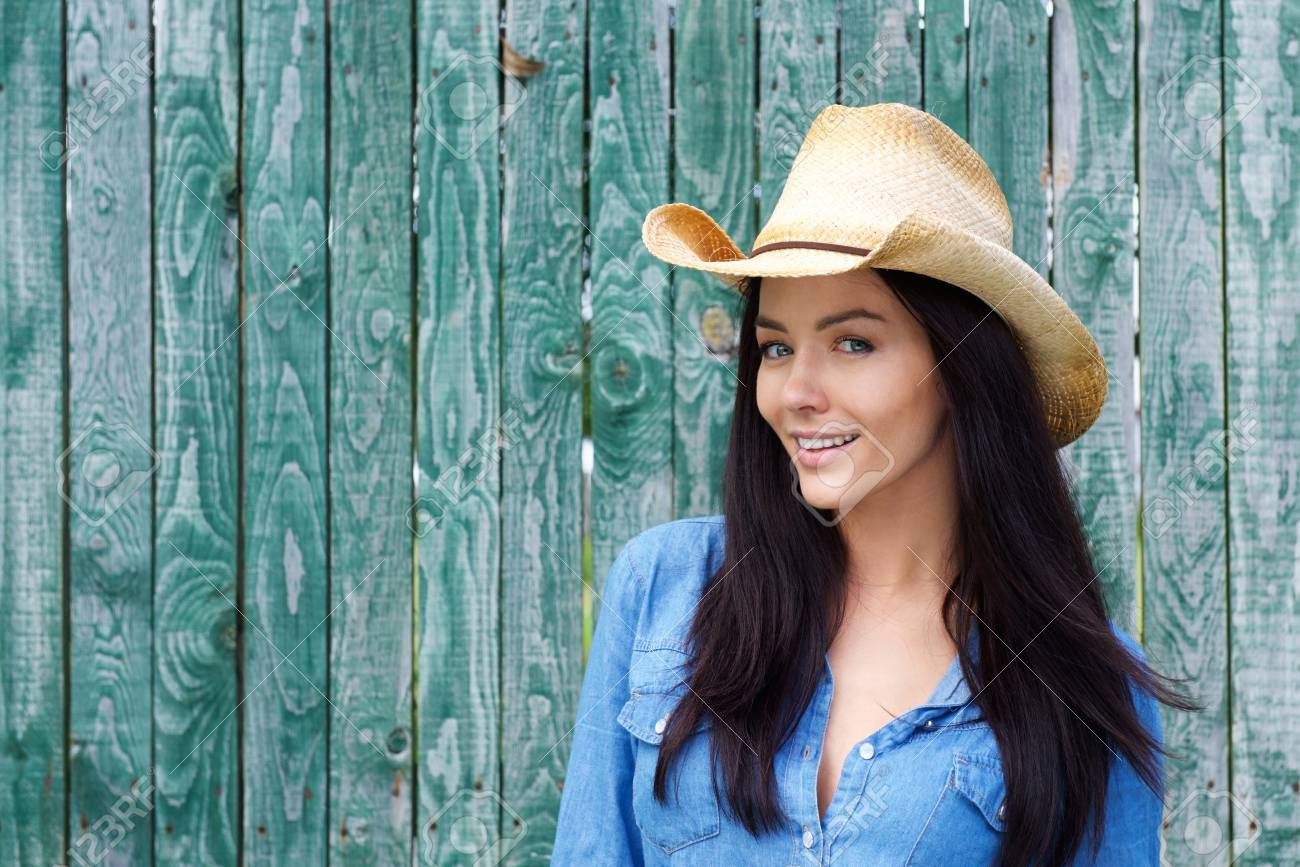 Close up portrait of a smiling young woman wearing cowboy hat Stock Photo -  50593438 274f201cb403