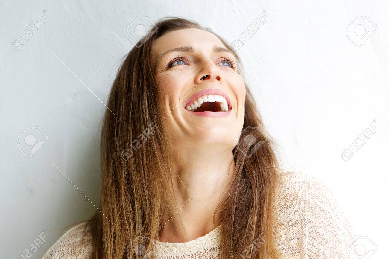 Close up portrait of a beautiful middle aged woman laughing against white background - 52534567