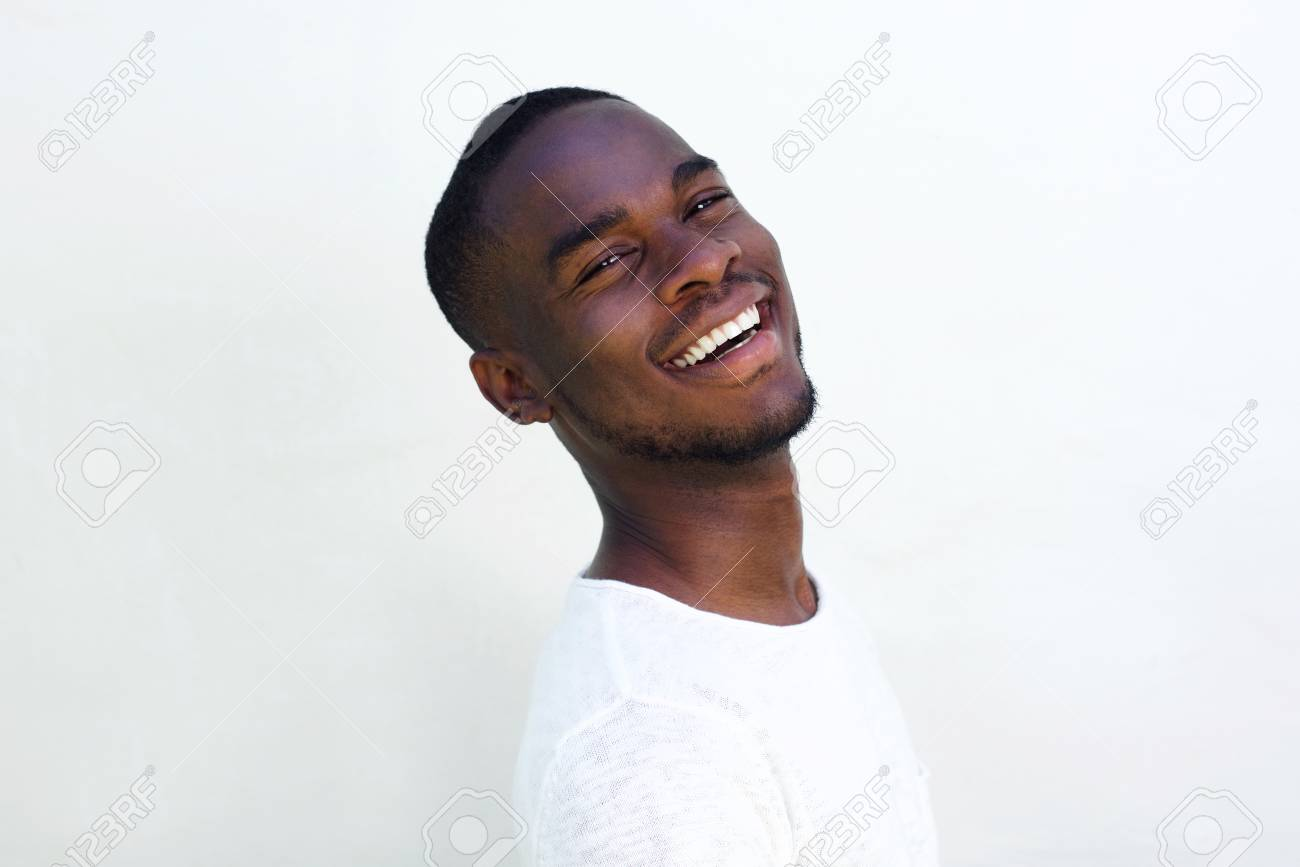 3a1a2319b02 Close up portrait of cheerful young black guy laughing against white  background Stock Photo - 55542856