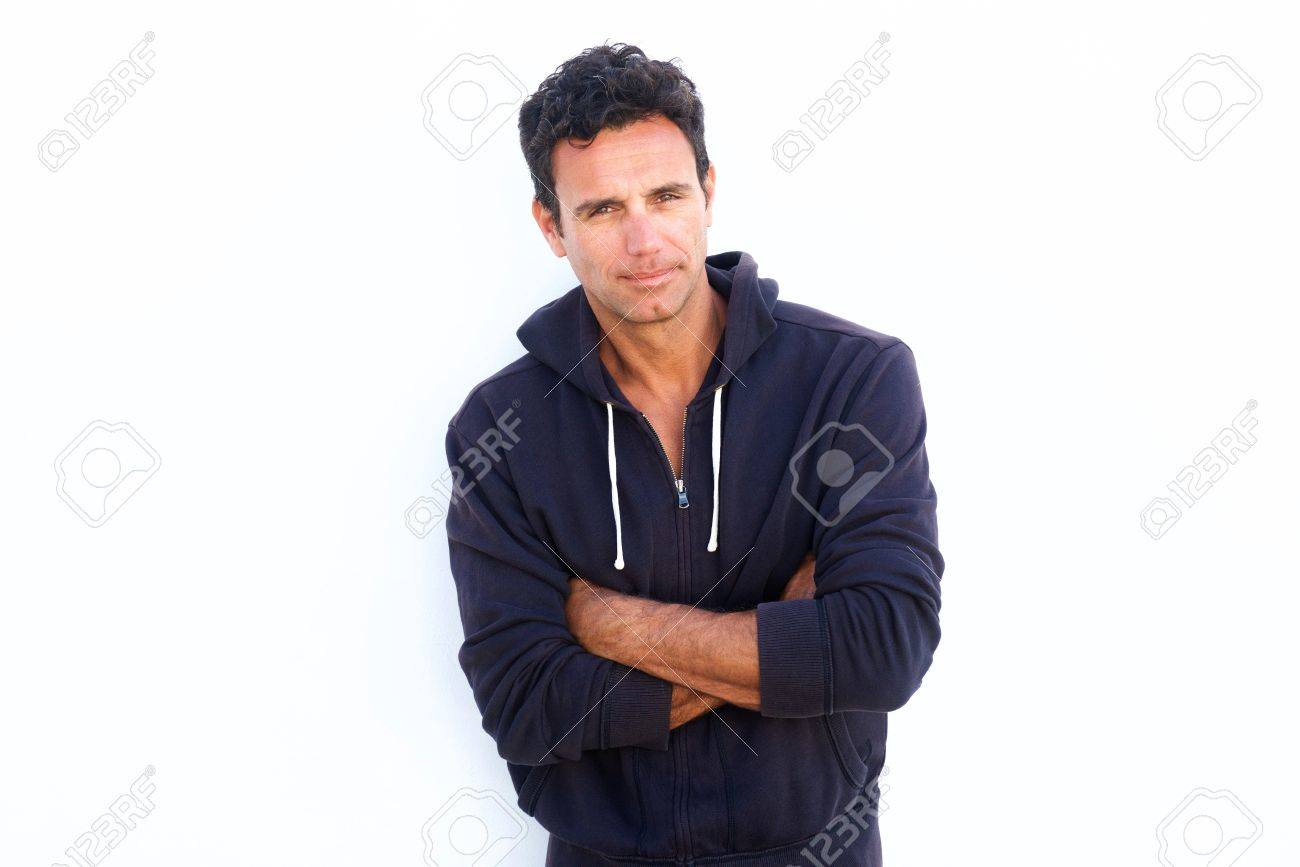 Portrait of a rugged handsome middle aged man standing with arms crossed against white background - 55806100
