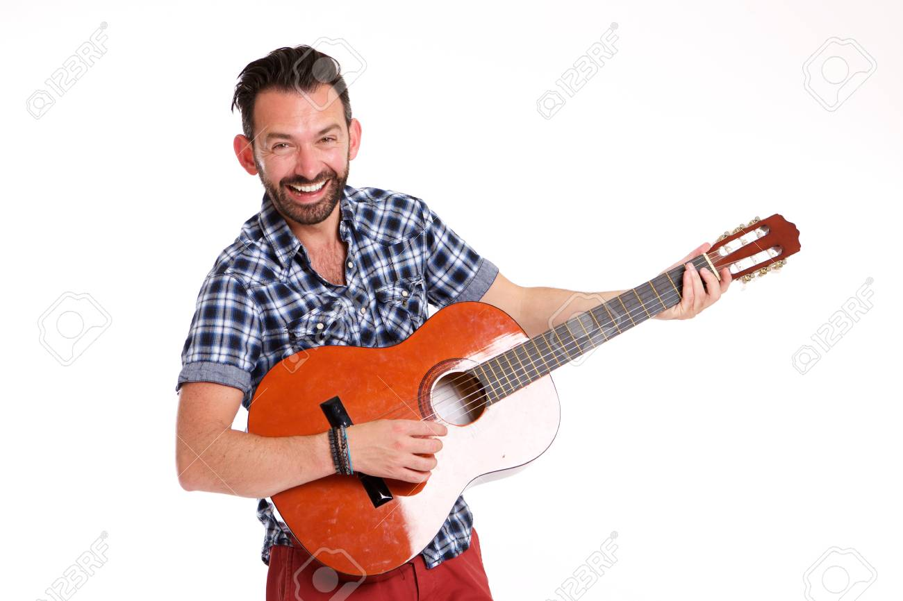 portrait of excited mature man playing guitar against white