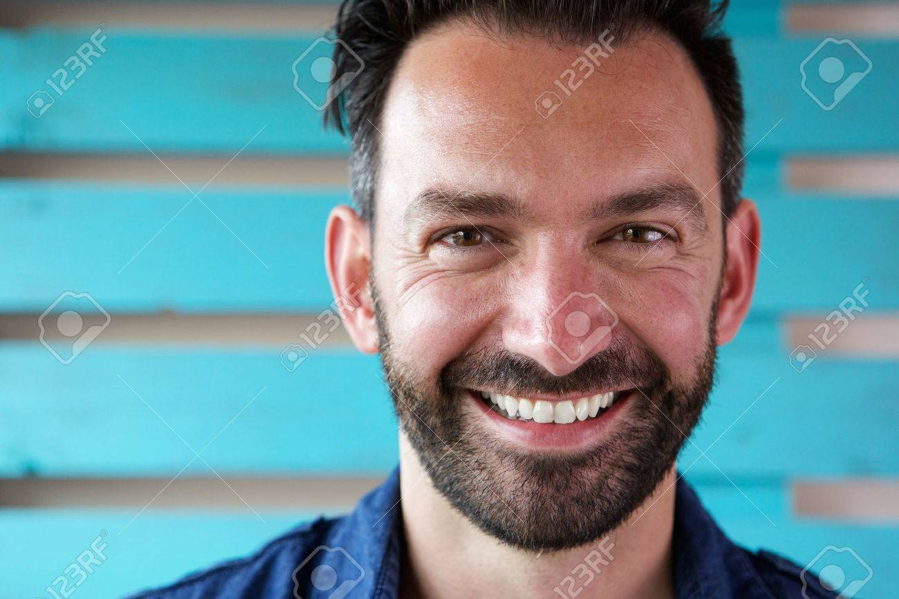 Close up portrait of handsome mature man with beard smiling - 63536572