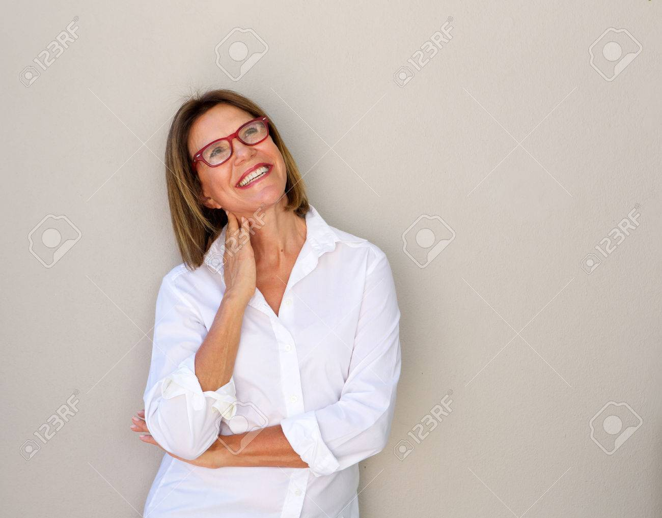 Portrait of smiling business woman with glasses looking up - 72409731