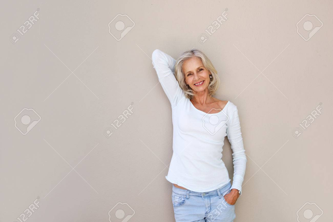 Portrait of happy carefree older woman with hand by head - 74022110
