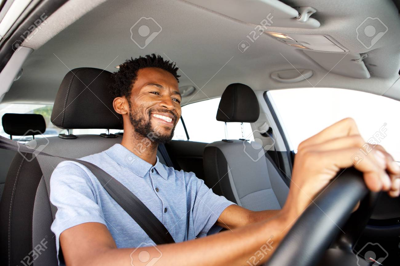 Close up side portrait of happy african american man driving car - 76365063