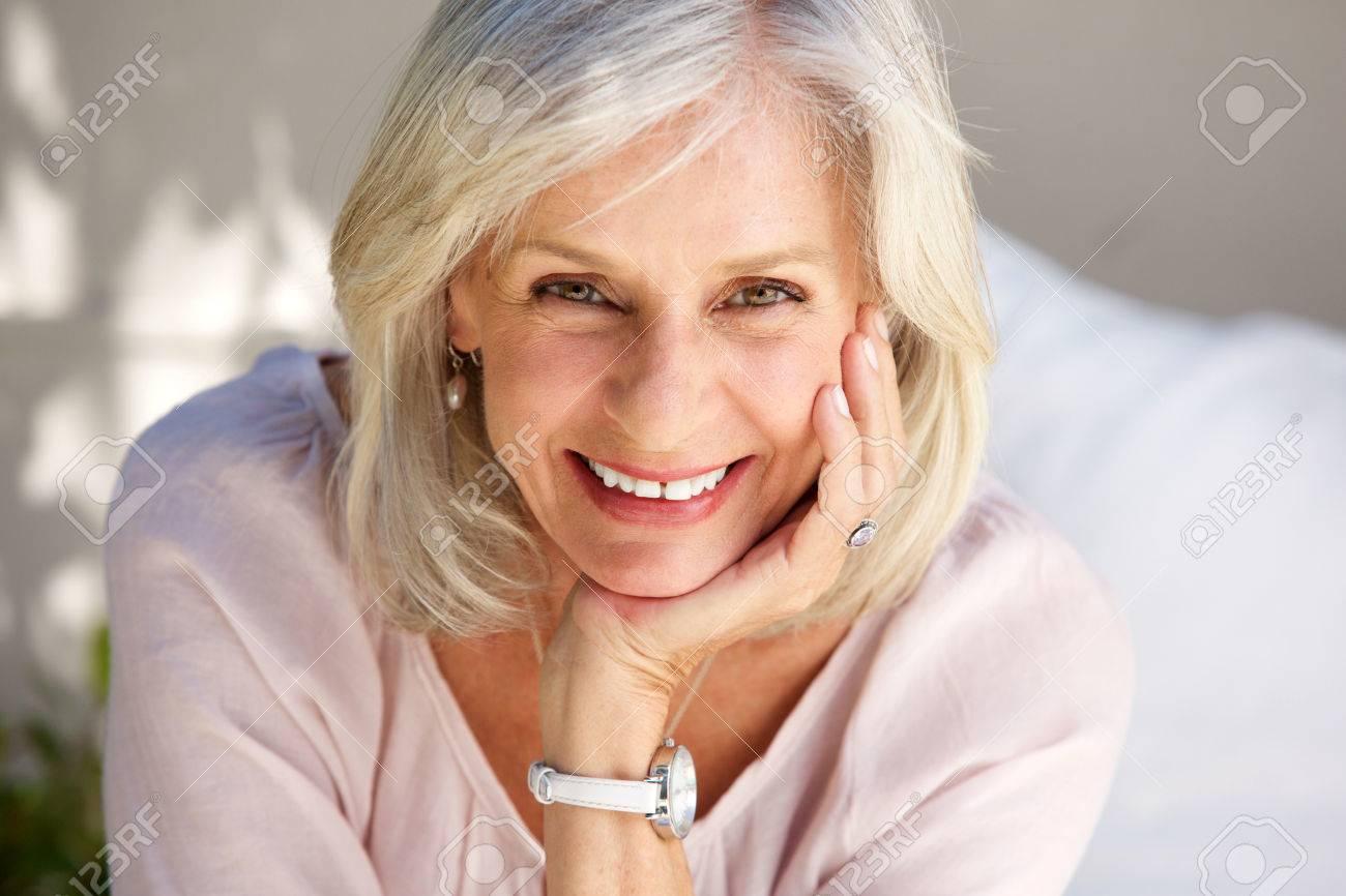 Close up portrait of mature woman smiling outside - 80539360