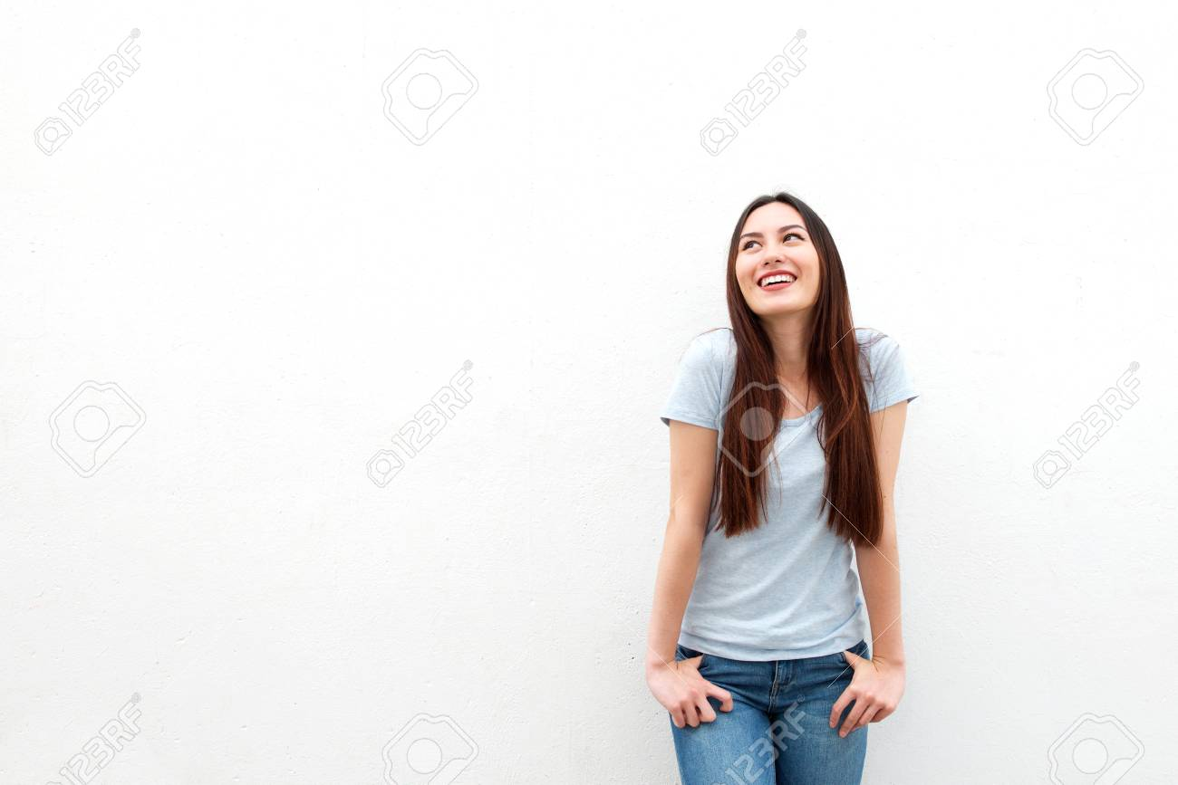 Portrait of cute young woman smiling and looking up on white background - 81809216