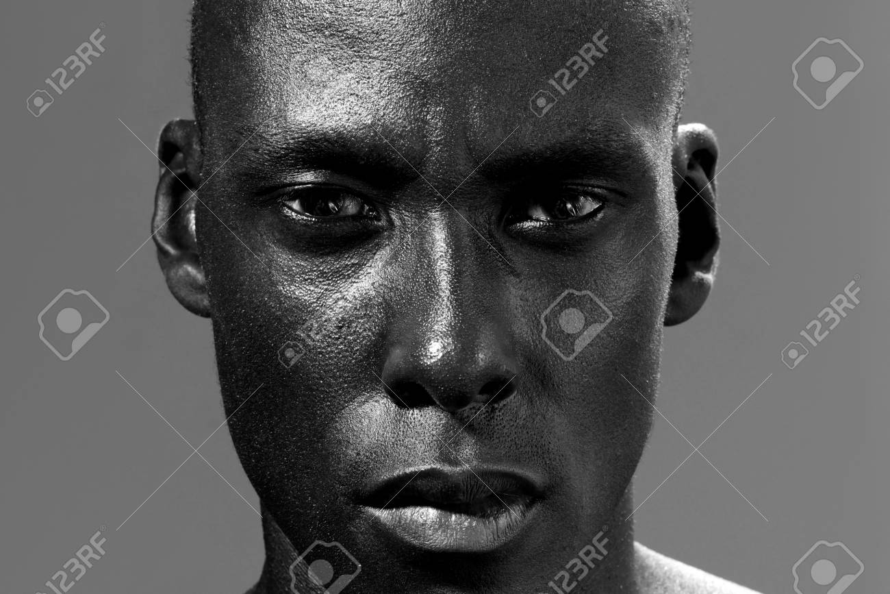 Close up black and white photo of african american man staring stock photo 96277807