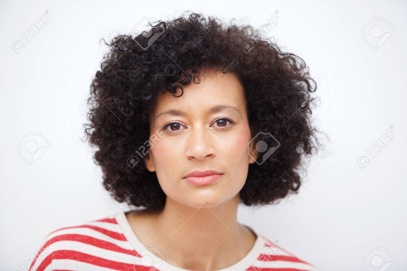 Close up front portrait of and older african american woman against white wall - 113690258