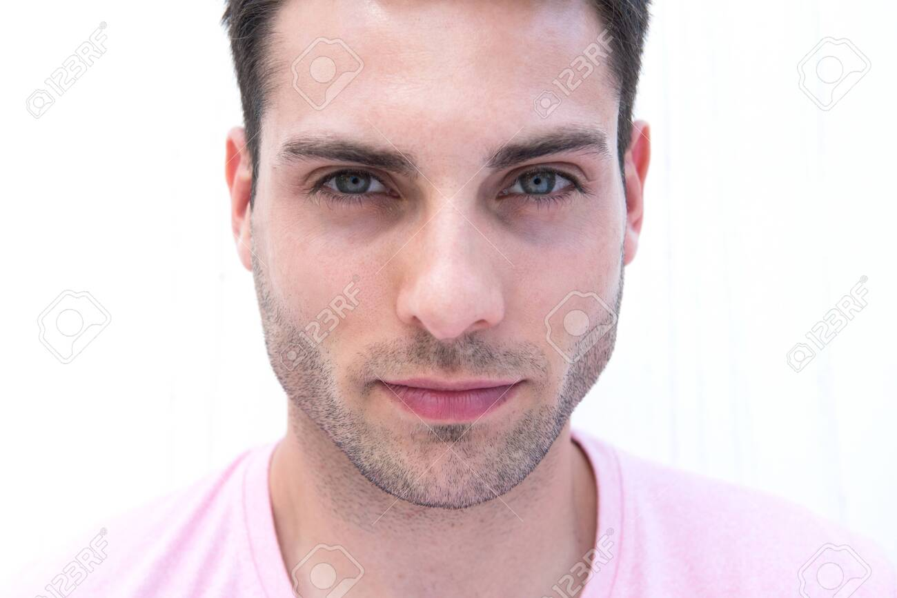 Close up front portrait of handsome young man staring by white background - 139300062
