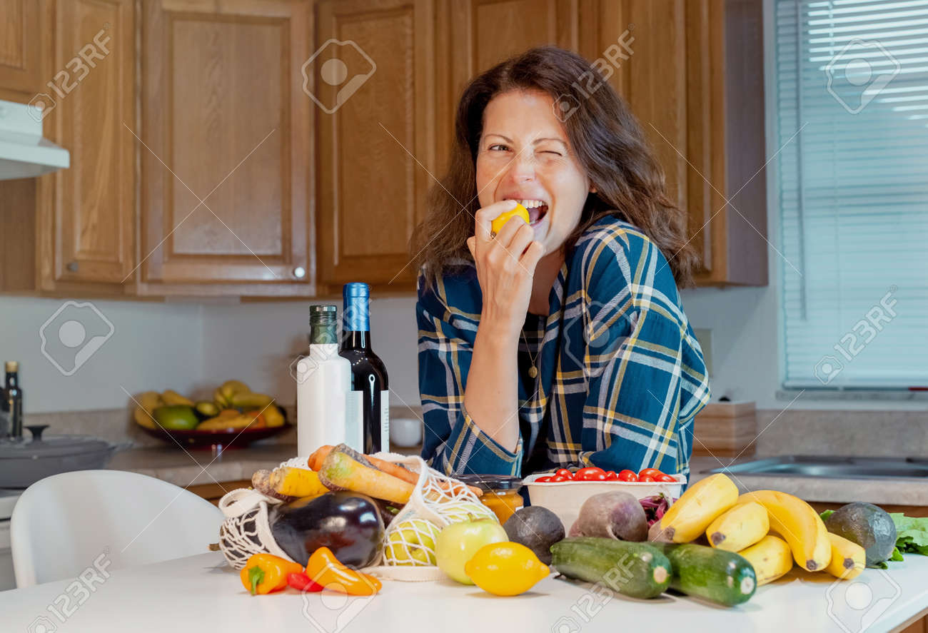 Portrait Of Young Housewife With Local Market Purchases In Kitchen Stock Photo Picture And Royalty Free Image Image 155865520