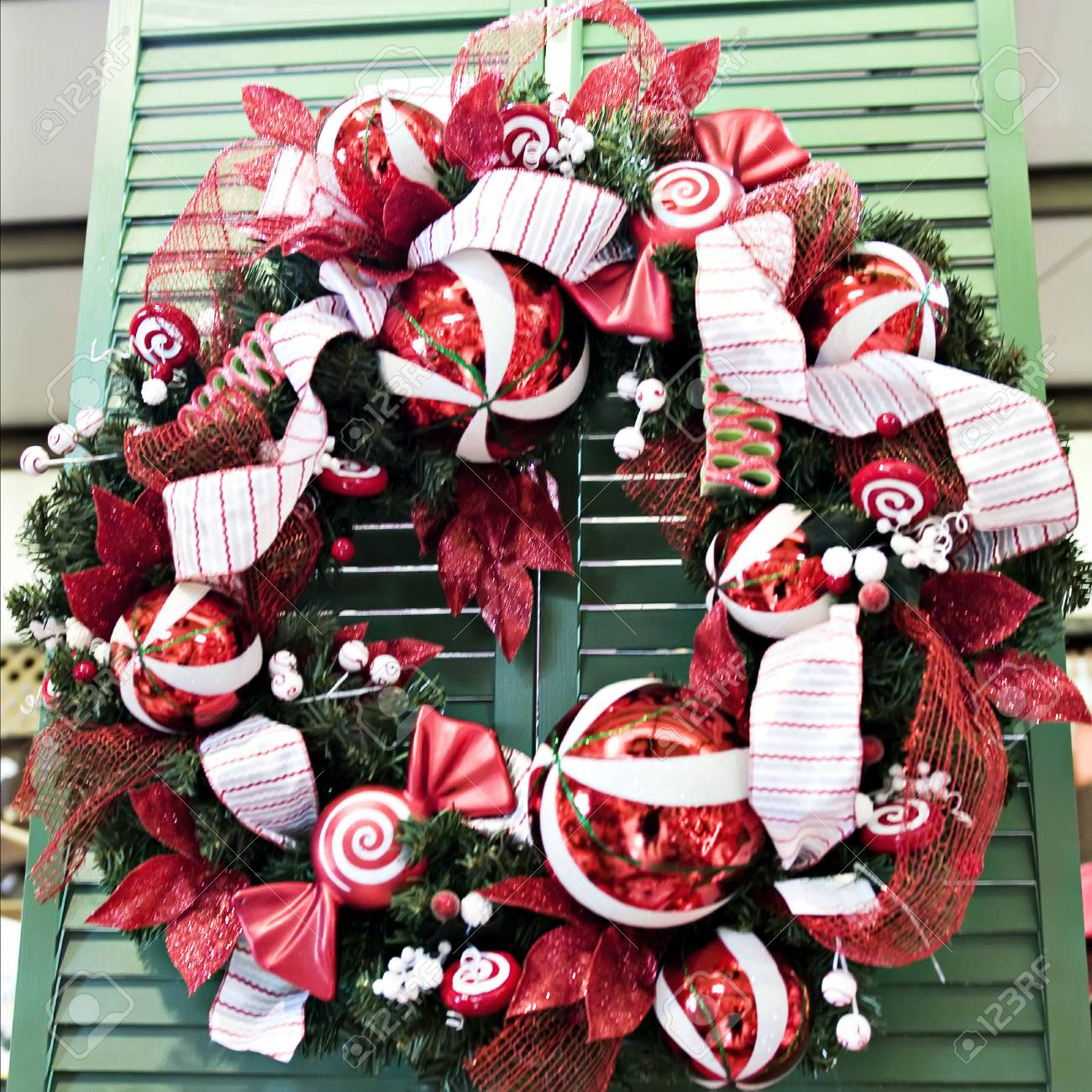 A Red And White Christmas Wreath With Ornaments Stock Photo Picture