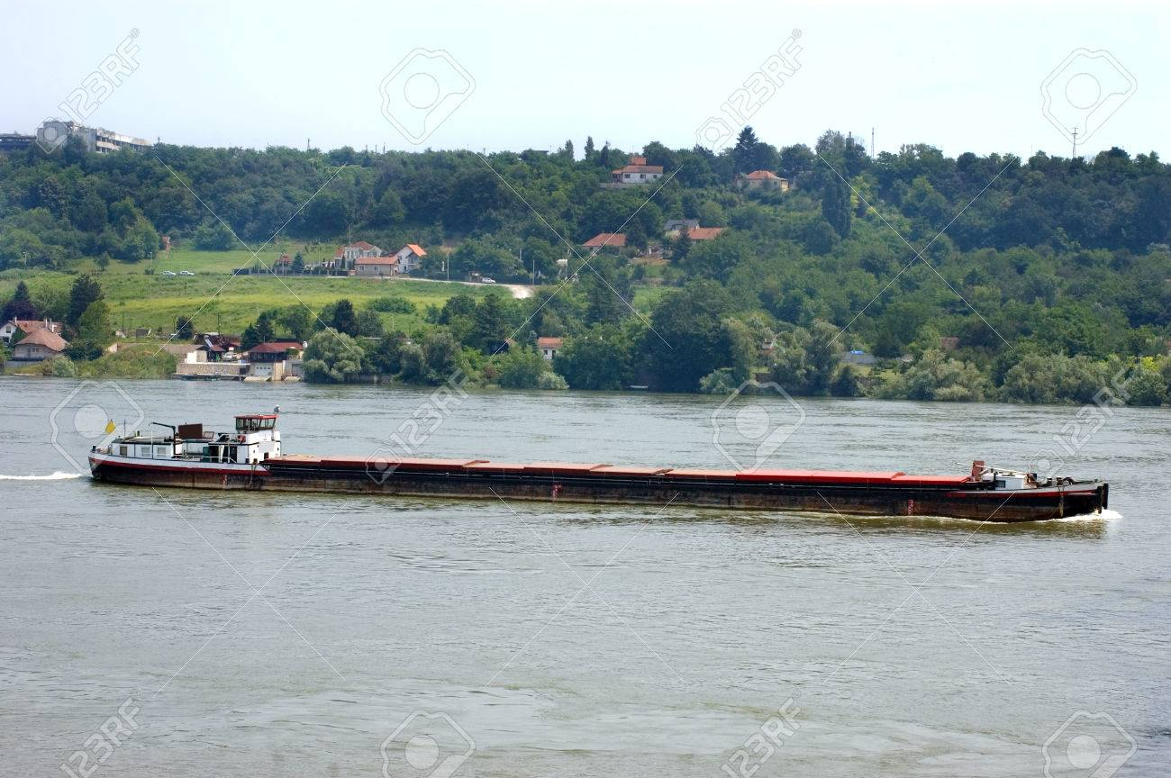 River transportation with freight ship on a river Danube in Serbia