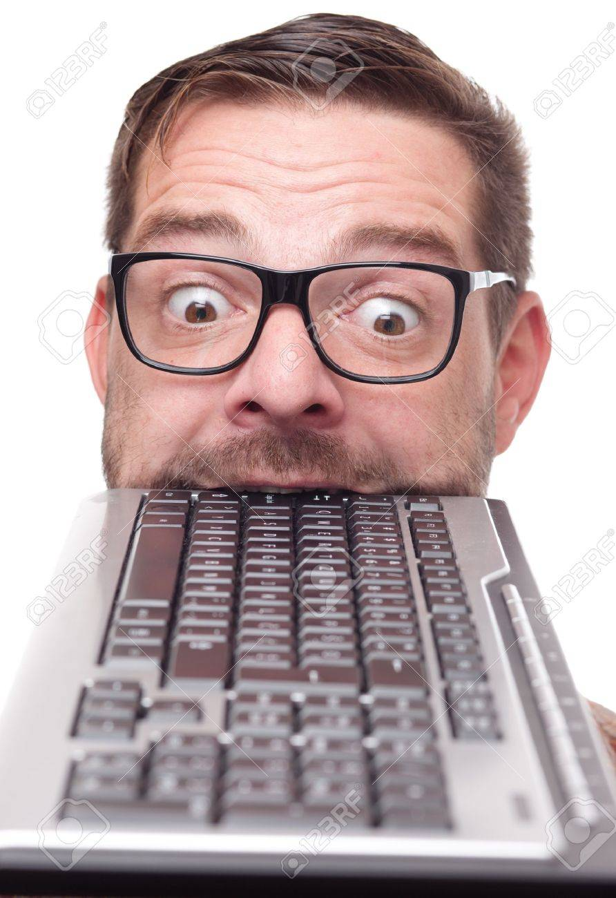 Eccentric nerd with keyboard in his mouth Stock Photo - 9689315