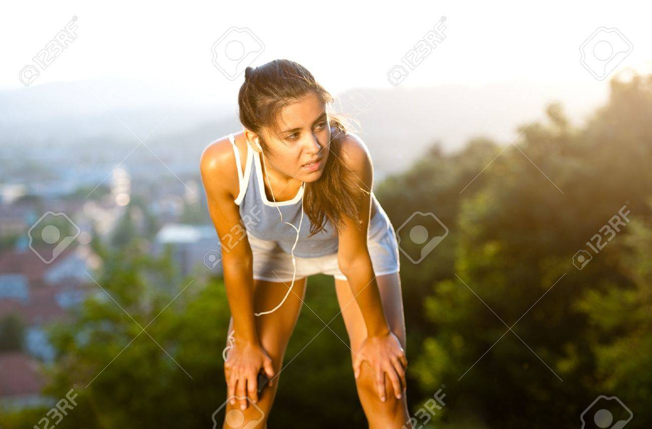 Fit young woman catching her breath during training Stock Photo - 9951559
