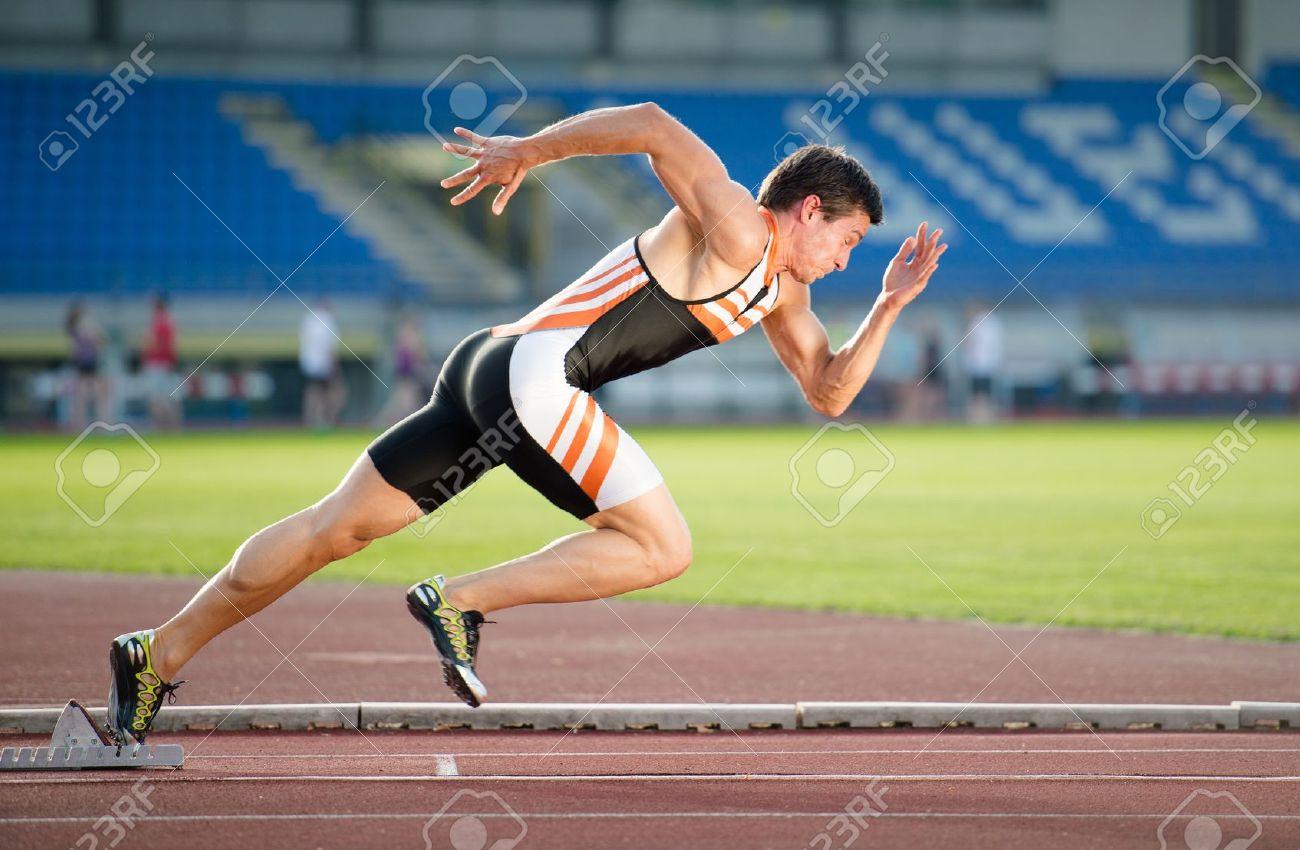 Sprinter leaving starting blocks on the running track. Explosive start. Stock Photo - 14160474