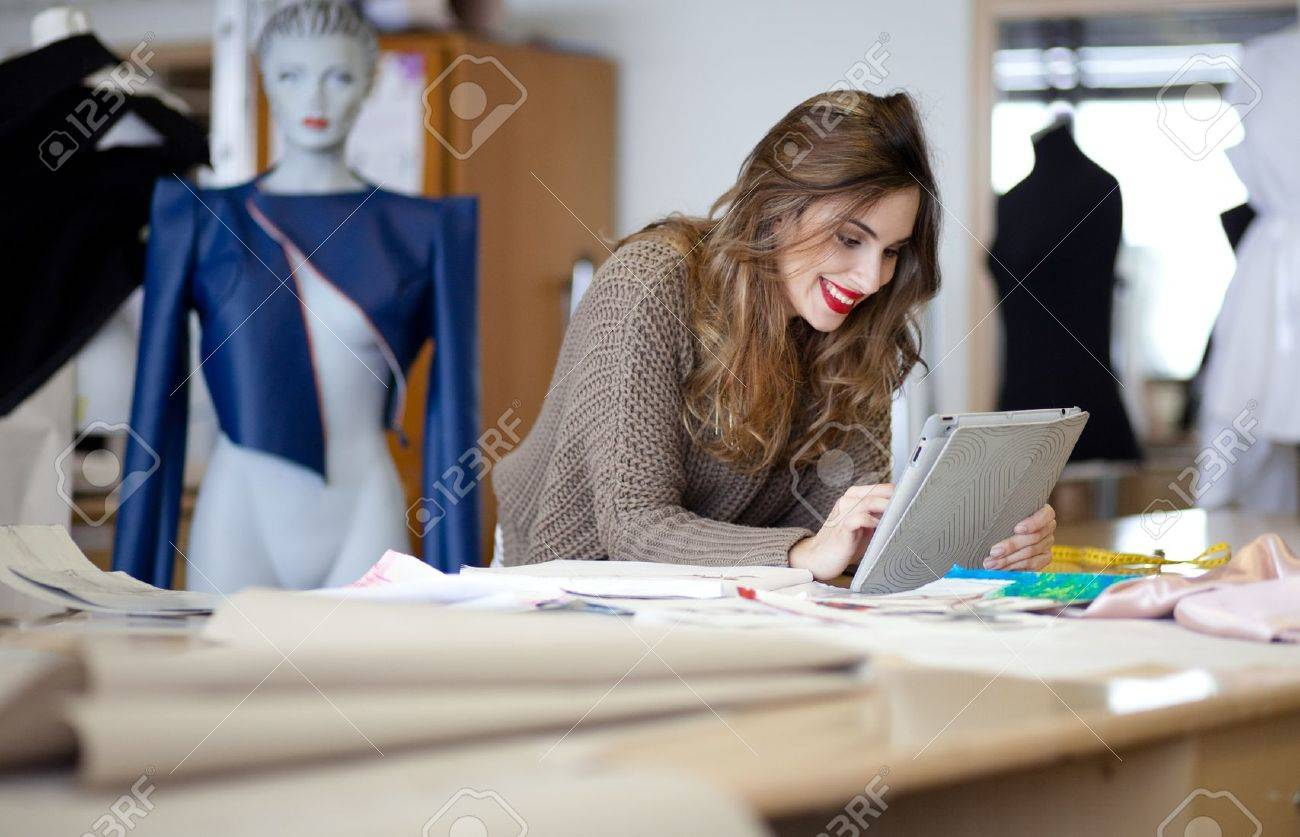 Fashion Designer Using Tablet Computer In The Studio Stock Photo Picture And Royalty Free Image Image 17822814
