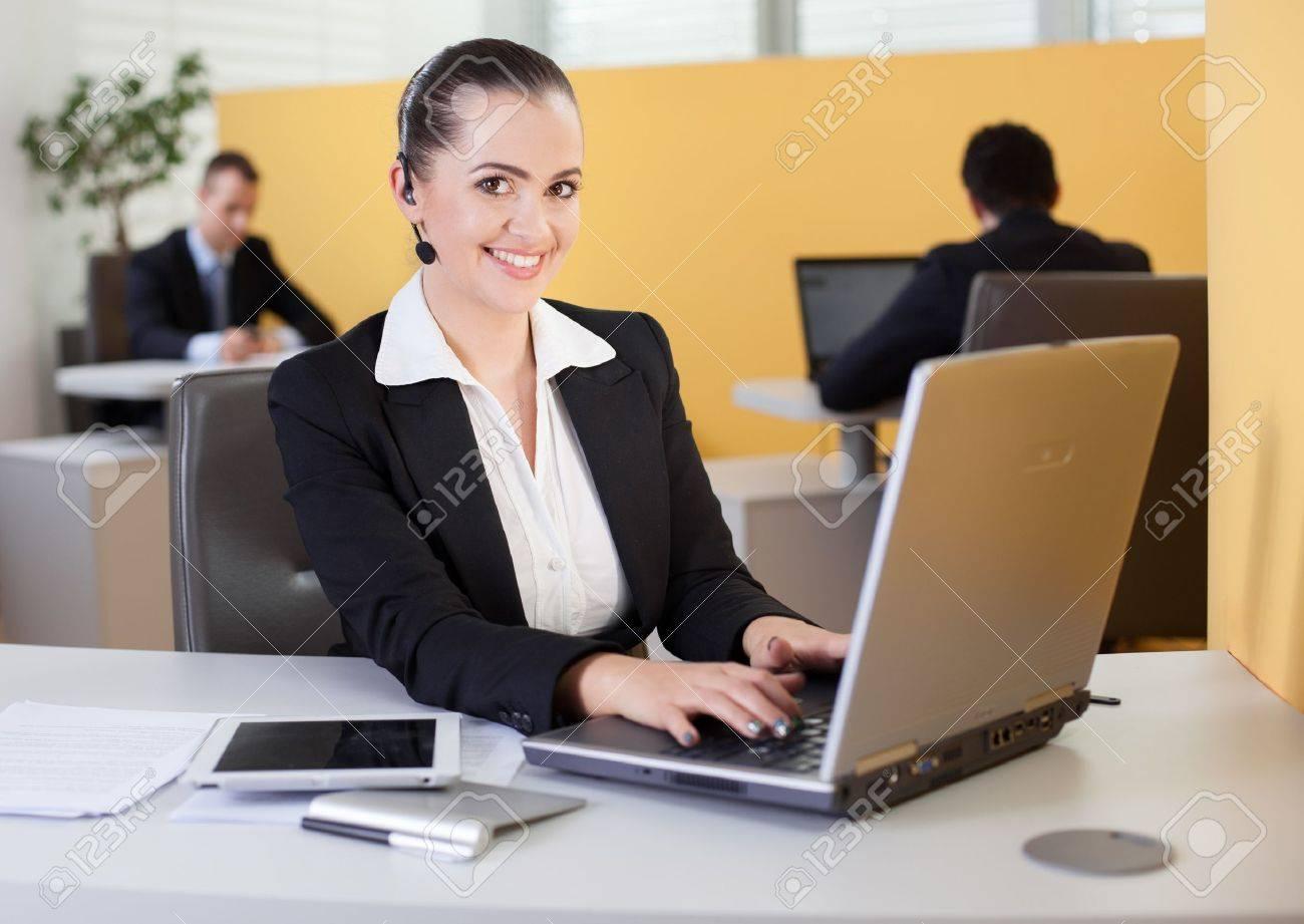 friendly customer service employee working in the office stock friendly customer service employee working in the office stock photo 19380086