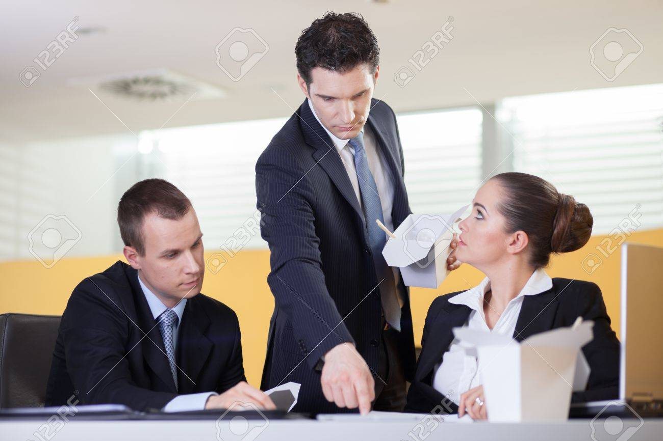annoying supervisor giving his coworkers a hard time during lunch