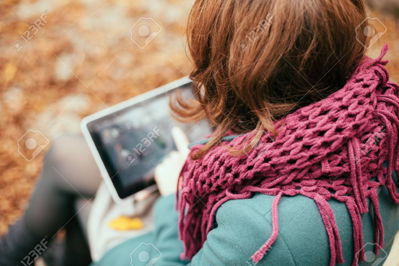 Woman using tablet computer outdoors Stock Photo - 23129874