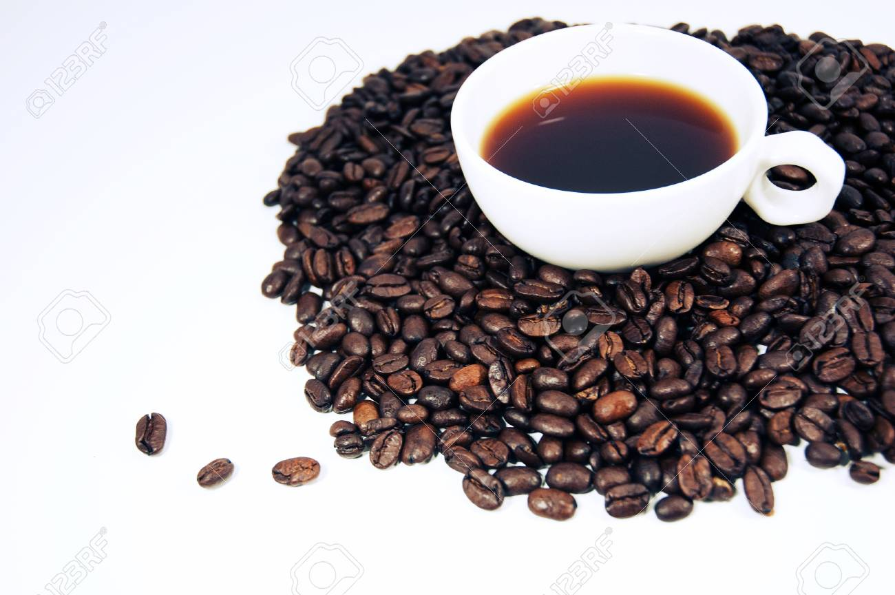 coffee cup on coffee beans - 15490717