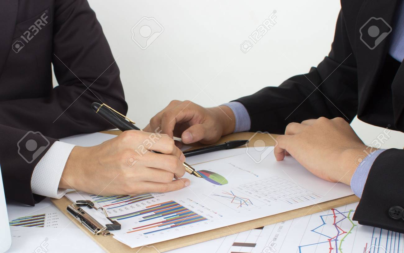 two business men review the documents - 15443294