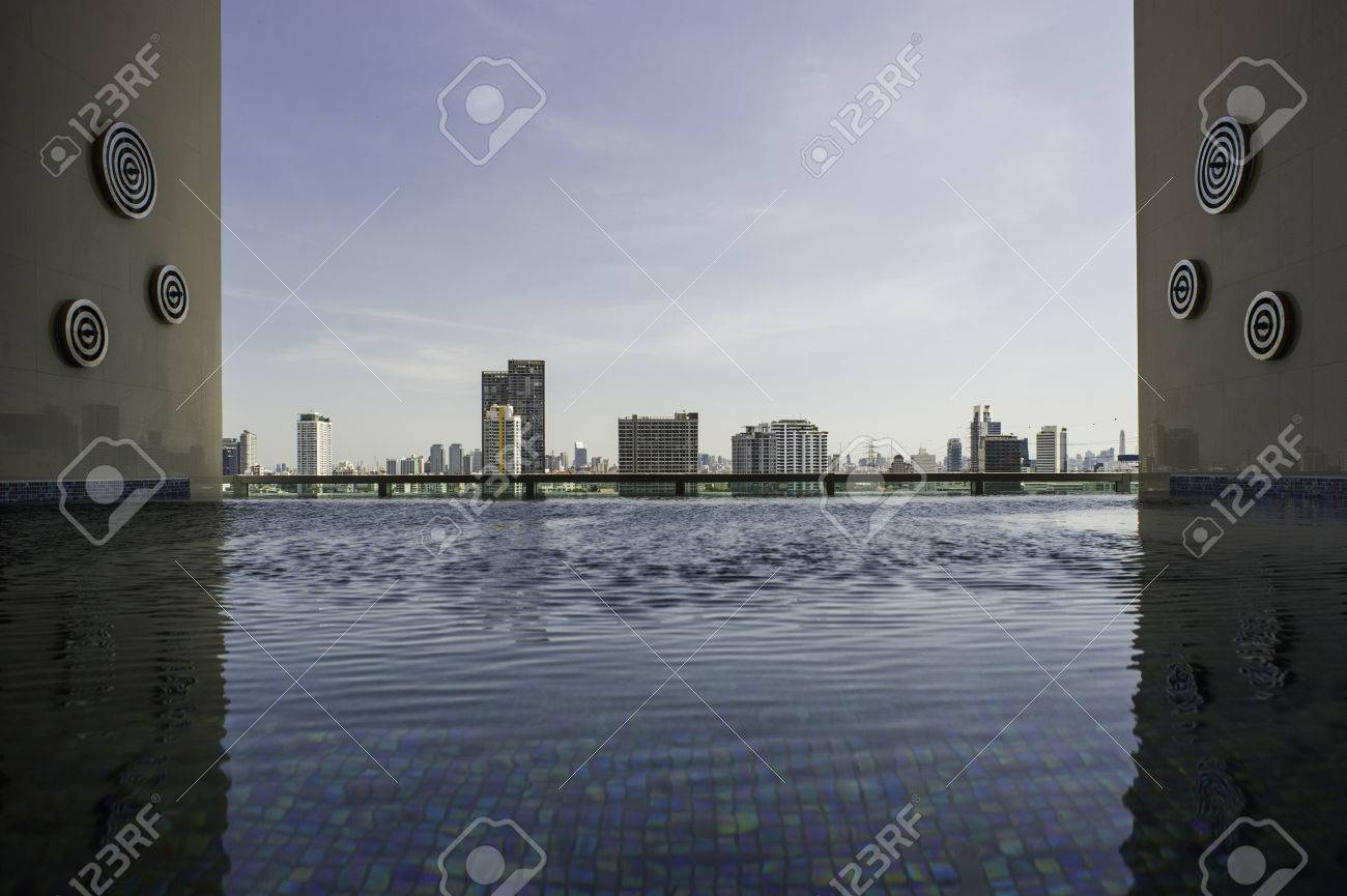 Skyline cityscape view from infinity edge swimming pool