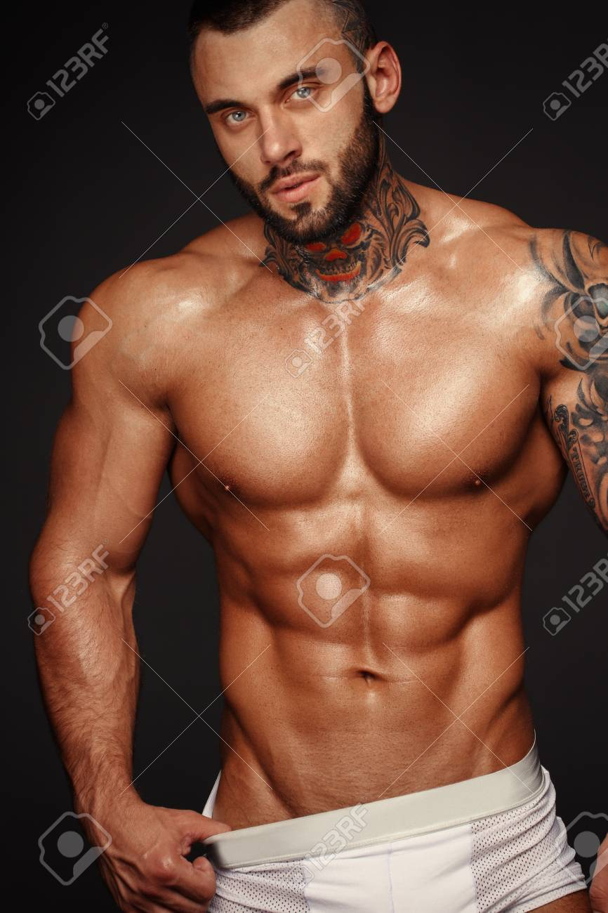 Sexy closeup portrait of handsome topless male model with beautiful eyes sexy man or muscular macho bodybuilder with muscle torso body with six packs