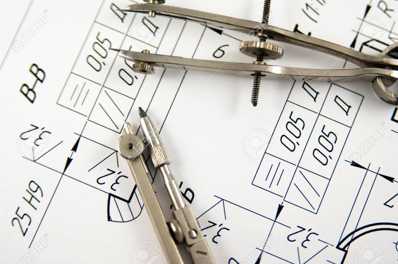 A closeup view of an architects drafting table showing a blueprint a closeup view of an architects drafting table showing a blueprint and two compasses stock photo malvernweather Choice Image