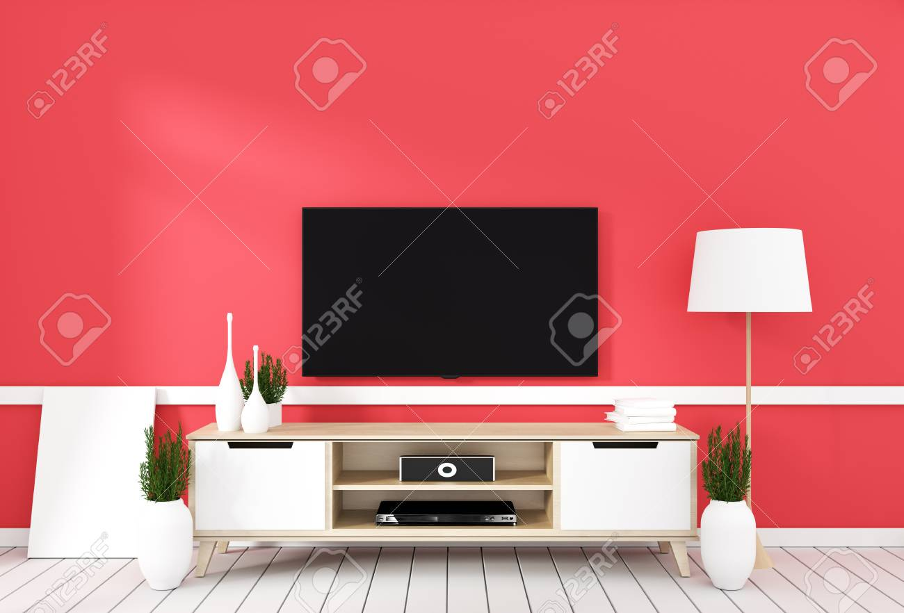 TV on cabinet in modern living room with lamp,plant on red wall..