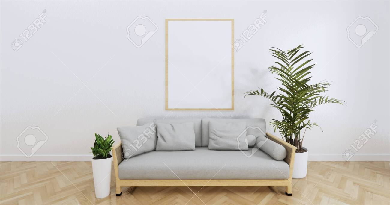 Poster above white sofa with frame in simple zen living room..