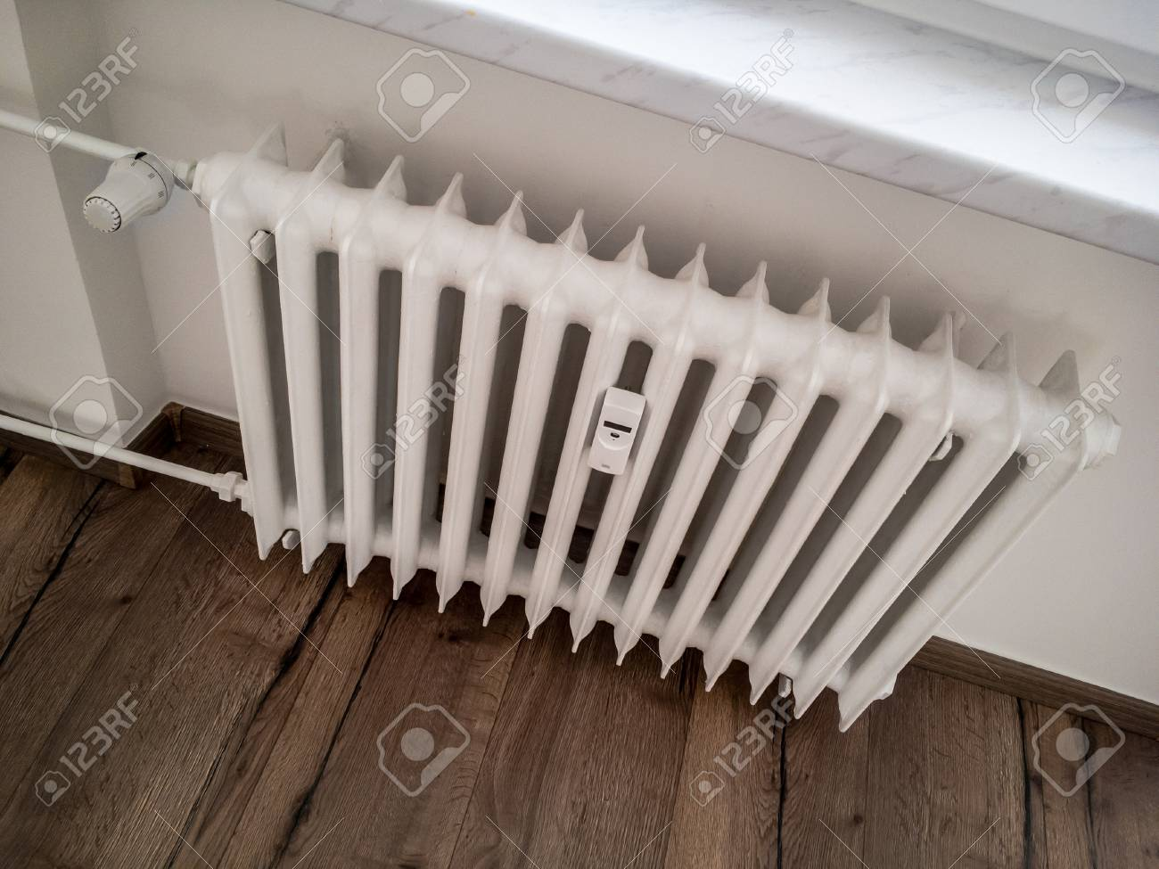 Old White Radiator With An Adjustment Valve In A Reconstructed Stock Photo Picture And Royalty Free Image Image 98895287
