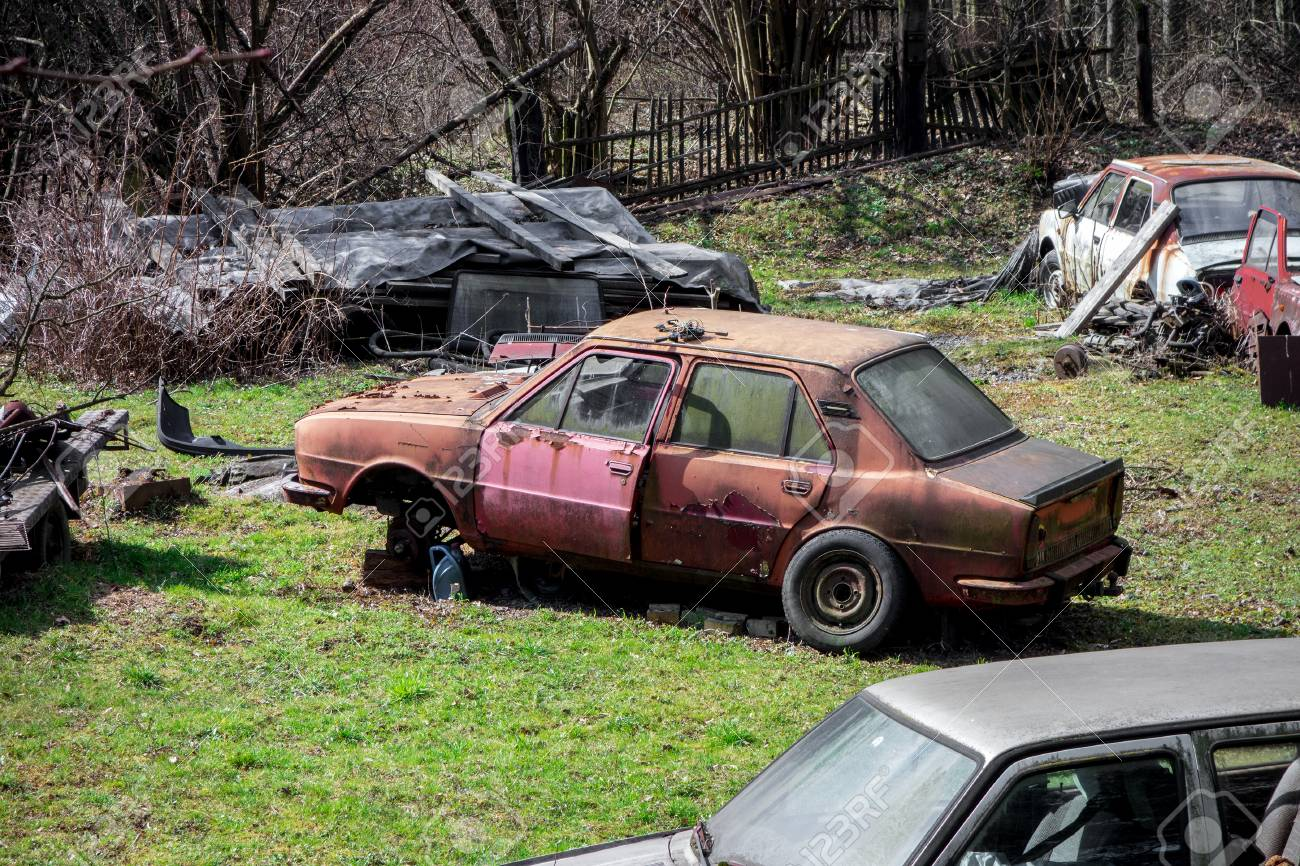 Scrapyard On A Former Garden Full Of Old Abandoned Cars Mostly ...
