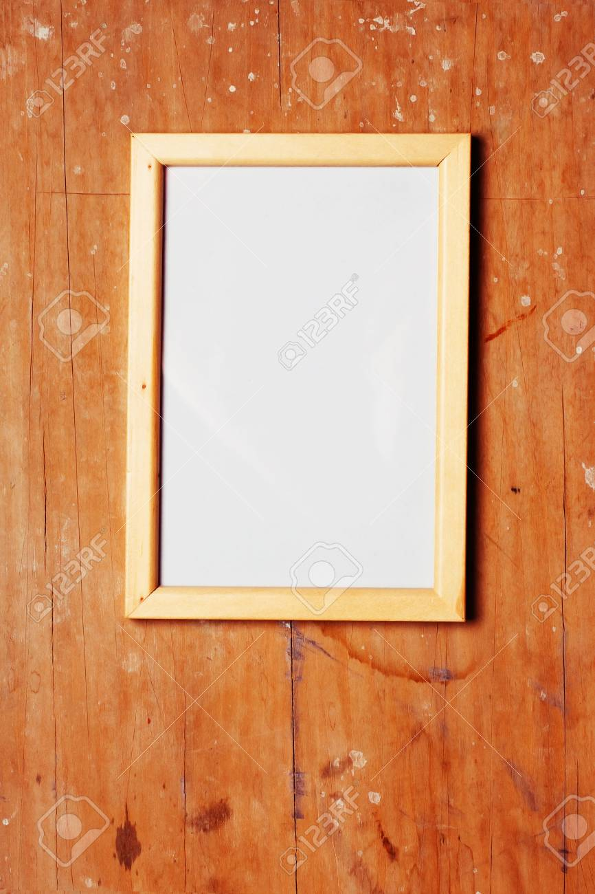 photoframe on wooden dirty background Stock Photo - 8703497