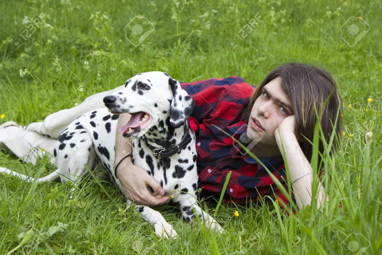 boy and the dalmatian dog on the grass Stock Photo - 13584394